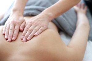 Close up of back massage procedure in spa salon